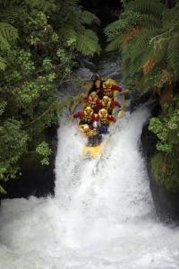 Rafting the 7 metre Tutea falls on the Kaituna River, Rotorua, New Zealand