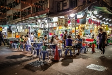 """Bourdain visited an outdoor _dai pai dong_ on almost every one of his visits to Hong Kong - street stalls with cheap, delicious food. """"Pull up a plastic stool, crack a beer and fire up the wok,"""" he once wrote. (4)"""